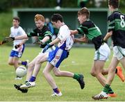 25 June 2016; Mark Harrington of New York in action against Ryan O'Leary and Robert Dillon of Nemo Rangers during the John West Féile Peile na nÓg at Dr Crokes in Killarney. Photo by Michelle Cooper Galvin/Sportsfile