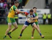 25 June 2016; Dessie Mone of Monaghanl in action against Christy Toye and Eoin McHugh of Donegal during the Ulster GAA Football Senior Championship Semi-Final game between Donegal and Monaghan at Kingspan Breffni Park in Cavan. Photo by Oliver McVeigh/Sportsfile