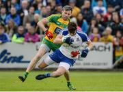 25 June 2016; Darren Hughes of Monaghanl in action against Christy Toye of Donegal during the Ulster GAA Football Senior Championship Semi-Final game between Donegal and Monaghan at Kingspan Breffni Park in Cavan. Photo by Oliver McVeigh/Sportsfile