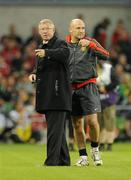 4 August 2010; Manchester United manager Sir Alex Ferguson, left, and assistant manager Mike Phelan during the game. Friendly Match, Airtricity League XI v Manchester United, Aviva Stadium, Lansdowne Road, Dublin. Picture credit: David Maher / SPORTSFILE