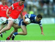 8 July 2001; Paul Finlay, Monaghan, in action against Sean Kavanagh, Tyrone. Tyrone v Monaghan, Ulster Minor Football Championship Final, St. Tighearnach's Park, Clones, Co. Monaghan. Picture credit; David Maher / SPORTSFILE