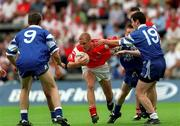 8 July 2001; Paul Rafferty, Tyrone, in action against Francis Markey, 19, and Glen Cumiskey, 19, Monaghan. Tyrone v Monaghan, Ulster Minor Football Championship Final, St. Tighearnach's Park, Clones, Co. Monaghan. Picture credit; David Maher / SPORTSFILE