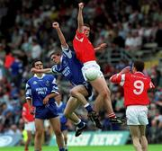 8 July 2001; Peter Donnelly, Tyrone, and Paul Finlay, Monaghan, contest a dropping ball. Tyrone v Monaghan, Ulster Minor Football Championship Final, St. Tighearnach's Park, Clones, Co. Monaghan. Picture credit; David Maher / SPORTSFILE