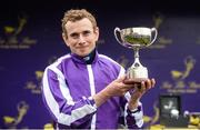 26 June 2016; Jockey Ryan Moore with the trophy after winning the Sea The Stars Pretty Polly Stakes on Minding at the Curragh Racecourse in the Curragh, Co. Kildare. Photo by Cody Glenn/Sportsfile