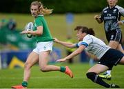 26 June 2016; Aoife Doyle of Ireland evades the tackle of Nigora Nurmatova of Kazakhstan on her way to scoring her side's second try during the World Rugby Women's Sevens Olympic Repechage Championship Bronze Medal match between Ireland and Kazakhstan at UCD Sports Centre in Belfield, Dublin. Photo by Seb Daly/Sportsfile