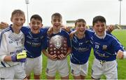 26 June 2016; Celbridge, Co. Kildare, players from left Thomas Dunne,1, and his twin brother Emmet Dunne, 19, with triplets Aidan, Ciaran and Sean Hancock celebrate winning the John West Féile Peile na nÓg Division 1 Shield Final against Killarney Legion, Co. Kerry at Austin Stack Park in Tralee, Co Kerry.  Photo by Matt Browne/Sportsfile