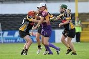 14 August 2010; Wexford's goal-keeper Mags D'Arcy is tackled by Kelly Hamilton, left, and Collette Dormer, Kilkenny. Gala All-Ireland Senior Camogie Championship Semi-Final, Kilkenny v Wexford, Nowlan Park, Kilkenny. Picture credit: Matt Browne / SPORTSFILE