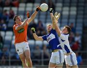 2 July 2016; Rory Grugan of Armagh in action against Mark Timmons and Graham Brody, right, of Laois, during the GAA Football All-Ireland Senior Championship Round 1A Refixture at O'Moore Park in Portlaoise, Co. Laois. Photo by Paul Mohan/Sportsfile