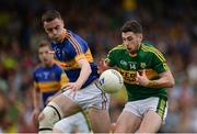 3 July 2016; Paul Geaney of Kerry in action against Alan Campbell of Tipperary during the Munster GAA Football Senior Championship Final match between Kerry and Tipperary at Fitzgerald Stadium in Killarney, Co Kerry. Photo by Brendan Moran/Sportsfile