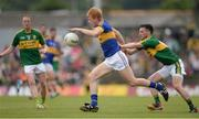 3 July 2016; Josh Keane of Tipperary in action against Paul Murphy of Kerry during the Munster GAA Football Senior Championship Final match between Kerry and Tipperary at Fitzgerald Stadium in Killarney, Co Kerry. Photo by Brendan Moran/Sportsfile