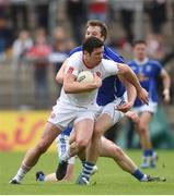 3 July 2016; Sean Cavanagh of Tyrone is tackled by Gearoid McKiernan of Cavan during the Ulster GAA Football Senior Championship Semi-Final Replay between Tyrone and Cavan at St Tiemach's Park in Clones, Co Monaghan. Photo by Ramsey Cardy/Sportsfile