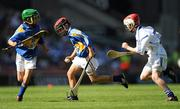 15 August 2010; Oisín Grant, Gaelscoil Bhun Cranncha, Co. Donegal, and Matthew Walsh, Larmenier and Sacred Heart P.S., London, left, representing Tipperary, in action against John Mullins, Scoil Eoin Baiste S.N.S., Clontarf, Co. Dublin, representing Waterford. GAA INTO Mini-Sevens during half time of the GAA Hurling All-Ireland Senior Championship Semi-Final, Waterford v Tipperary, Croke Park, Dublin. Picture credit: Stephen McCarthy / SPORTSFILE