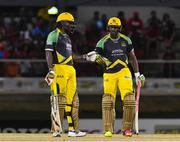 4 July 2016; Chris Gayle, left, and Andre Russell of Jamaica Tallawahs during Match 7 of the Hero Caribbean Premier League between Trinbago Knight Riders and Jamaica Tallawahs at Queen's Park Oval, in Port of Spain, Trinidad. Photo by Randy Brooks/Sportsfile