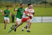 9 July 2016; Danny Heavron of Derry in action against Graham Reilly of Meath during the GAA Football All-Ireland Senior Championship - Round 2A match between Derry and Meath at Derry GAA Centre of Excellence in Owenbeg, Derry. Photo by Oliver McVeigh/Sportsfile