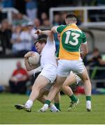 9 July 2016; Niall Kelly of Kildare in action against Graham Guilfoyle and Niall Darby of Offaly, behind, during the GAA Football All-Ireland Senior Championship - Round 2B match between Kildare and Offaly at St Conleth's Park in Newbridge, Kildare. Photo by Piaras Ó Mídheach/Sportsfile