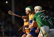 9 July 2016; Aron Shanagher of Clare in action against Tom Condon of Limerick, 2, and James Ryan of Limerick during the GAA Hurling All Ireland Senior Championship Round 2 match between Clare and Limerick at Semple Stadium in Thurles, Tipperary. Photo by Eóin Noonan/Sportsfile