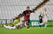 24 August 2010; Gary Burke, Bohemians A, gets past Jamie Duffy, Sporting Fingal A, to shoot and score his side's first goal. Newstalk Cup Final, Bohemians A v Sporting Fingal A, Dalymount Park, Dublin. Picture credit: Barry Cregg / SPORTSFILE