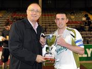 24 August 2010; Phillip Hand, Sporting Fingal A, receives the cup from Fran Gavin of the FAI. Newstalk Cup Final, Bohemians A v Sporting Fingal A, Dalymount Park, Dublin. Picture credit: Barry Cregg / SPORTSFILE