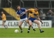10 July 2016; Gordon Kelly of Clare in action against Paul Cahillane of Laois during the GAA Football All-Ireland Senior Championship - Round 2A match between Clare and Laois at Cusack Park in Ennis, Clare. Photo by Piaras Ó Mídheach/Sportsfile