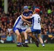 10 July 2016; John McGrath of Tipperary in action against Philip Mahony, left, and Tadhg de Burca of Waterford during the Munster GAA Hurling Senior Championship Final match between Tipperary and Waterford at the Gaelic Grounds in Limerick.  Photo by Ray McManus/Sportsfile