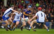 10 July 2016; John McGrath of Tipperary in action against Philip Mahony, left, Noel Connors and Tadhg de Burca of Waterford during the Munster GAA Hurling Senior Championship Final match between Tipperary and Waterford at the Gaelic Grounds in Limerick.  Photo by Ray McManus/Sportsfile
