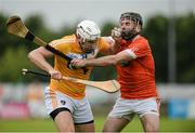10 July 16; Conor Carson of Antrim in action against Ciaran Clifford of Armagh during the Ulster GAA Hurling Senior Championship Final match between Antrim and Armagh at Derry GAA Centre of Excellence in Owenbeg, Derry. Photo by Oliver McVeigh/Sportsfile