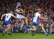 10 July 2016; John McGrath of Tipperary shoots past Tadhg de Burca of Waterford and Noel Connors, left, moments before ultimately scoring the first goal during the Munster GAA Hurling Senior Championship Final match between Tipperary and Waterford at the Gaelic Grounds in Limerick.  Photo by Ray McManus/Sportsfile