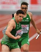 10 July 2016; Craig Lynch of Ireland takes the baton from team-mate Brian Gregan during the Men's 4 x 400m Final on day five of the 23rd European Athletics Championships at the Olympic Stadium in Amsterdam, Netherlands. Photo by Brendan Moran/Sportsfile