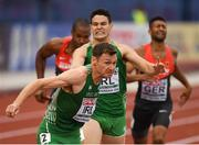 10 July 2016; David Gillick of Ireland takes the baton from team-mate Craig Lynch during the Men's 4 x 400m Final on day five of the 23rd European Athletics Championships at the Olympic Stadium in Amsterdam, Netherlands. Photo by Brendan Moran/Sportsfile