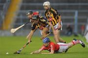28 August 2010; Michael Walsh, supported by Tadhg Healy, left, Cork, in action against Alan Healy, supported by Nicky Cleere, Kilkenny. GAA Hurling All-Ireland Intermediate Championship Final, Cork v Kilkenny, Semple Stadium, Thurles, Co. Tipperary. Picture credit: Diarmuid Greene / SPORTSFILE