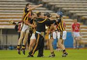 28 August 2010; Kilkenny players, from left to right, Nicky Cleere, Richie Dollard, Alan Healy and Niall Walsh celebrate with selector PJ Kenny after victory over Cork. GAA Hurling All-Ireland Intermediate Championship Final, Cork v Kilkenny, Semple Stadium, Thurles, Co. Tipperary. Picture credit: Diarmuid Greene / SPORTSFILE