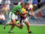 29 July 2001; Wexford's Rory McCarthy is tackled by Limerick's Clement Smith for a free which resulted in Damien Fitzhenry's second goal for Wexford. Wexford v Limerick, All-Ireland Hurling Quarter Final, Croke Park, Dublin. Picture credit; Damien Eagers / SPORTSFILE