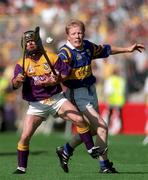 17 August 1997; Sean Flood, Wexford, in action against Tipperary's Aidan Ryan. Tipperary v Wexford, All-Ireland Hurling semi-final, Croke Park, Dublin. Picture credit; Matt Browne / SPORTSFILE