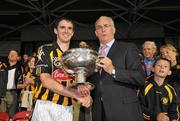 28 August 2010; Kilkenny captain Bill Beckett is presented with the cup by Sean Walsh, Chairman of the Munster Council, after victory over Cork. GAA Hurling All-Ireland Intermediate Championship Final, Cork v Kilkenny, Semple Stadium, Thurles, Co. Tipperary. Picture credit: Diarmuid Greene / SPORTSFILE
