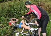16 July 2016; Leader of the King of the Mountains classification Eoghan McLoughlin of Connaught Team is offered a helping hand after collapsing at the finish of Stage 5 of the 2016 Scott Bicycles Junior Tour of Ireland, Gallows Hill, Co. Clare. Picture credit: Stephen McMahon/SPORTSFILE