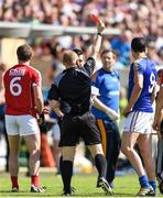 16 July 2016; Referee Barry Cassidy shows a red card to both James Loughrey, 6, of Cork  and Darren Gallagher, 9, of Longford during the GAA Football All-Ireland Senior Championship Round 3B match between Longford and Cork at Glennon Brothers Pearse Park in Longford. Photo by Ramsey Cardy/Sportsfile