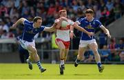 16 July 2016; Conor McAtamney of Derry in action against Gearoid McKiernan, left, and Tomas Corr of Cavan during the GAA Football All-Ireland Senior Championship Round 3A match between Cavan and Derry at Kingspan Breffni Park in Cavan. Photo by Brendan Moran/Sportsfile