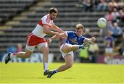 16 July 2016; Padraig Faulkner of Cavan gets in his kick as he is challenged by Mark Lynch of Derry during the GAA Football All-Ireland Senior Championship Round 3A match between Cavan and Derry at Kingspan Breffni Park in Cavan. Photo by Brendan Moran/Sportsfile