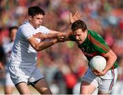 16 July 2016; Andy Moran of Mayo in action against David Hyland of Kildare during the GAA Football All-Ireland Senior Championship Round 3B match between Mayo and Kildare at Elverys MacHale Park in Castlebar, Mayo. Photo by Stephen McCarthy/Sportsfile