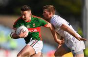 16 July 2016; Evan Regan of Mayo in action against Ollie Lyons of Kildare during the GAA Football All-Ireland Senior Championship Round 3B match between Mayo and Kildare at Elverys MacHale Park in Castlebar, Mayo. Photo by Stephen McCarthy/Sportsfile