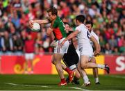 16 July 2016; Donal Vaughan of Mayo is tackled by Kildare goalkeeper Mark Donnellan during the GAA Football All-Ireland Senior Championship Round 3B match between Mayo and Kildare at Elverys MacHale Park in Castlebar, Mayo. Photo by Stephen McCarthy/Sportsfile