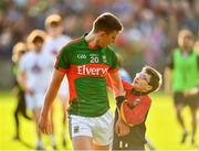 16 July 2016; Barry Moran of Mayo is greeted by a young supporter following the GAA Football All-Ireland Senior Championship Round 3B match between Mayo and Kildare at Elverys MacHale Park in Castlebar, Mayo. Photo by Stephen McCarthy/Sportsfile