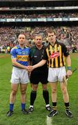 5 September 2010; Tipperary captain Eoin Kelly and Kilkenny captain TJ Reid shake hands across referee Michael Wadding before the start of the game. GAA Hurling All-Ireland Senior Championship Final, Kilkenny v Tipperary, Croke Park, Dublin. Picture credit: Ray McManus / SPORTSFILE