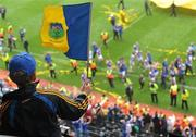5 September 2010; A young Tipperary supporter waves his flag as his team do a lap of honour with the Liam MacCarthy Cup after the game. GAA Hurling All-Ireland Senior Championship Final, Kilkenny v Tipperary, Croke Park, Dublin. Picture credit: Brendan Moran / SPORTSFILE