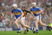 5 September 2010; Brendan Maher, supported by Michael Cahill, Tipperary, in action against Martin Comerford, Kilkenny. GAA Hurling All-Ireland Senior Championship Final, Kilkenny v Tipperary, Croke Park, Dublin. Picture credit: Ray McManus / SPORTSFILE