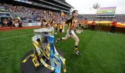 5 September 2010; Kilkenny captain T.J. Reid runs out on to the pitch past the Liam MacCarthy cup. GAA Hurling All-Ireland Senior Championship Final, Kilkenny v Tipperary, Croke Park, Dublin. Picture credit: Paul Mohan / SPORTSFILE