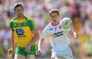 17 July 2016; Peter Harte of Tyrone in action against Christy Toye of Donegal during the Ulster GAA Football Senior Championship Final match between Donegal and Tyrone at St Tiernach's Park in Clones, Co Monaghan. Photo by Ramsey Cardy/Sportsfile