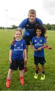 21 July 2016; Ross Molony of Leinster with Jessica Delaney, left, aged 6, from Portlaoise, Co. Laois, and Zion Onalimi, aged 7, from Mountmellick, Co. Laois, during the Bank of Ireland Leinster Rugby Summer Camp at Portlaoise RFC in Portlaoise, Co. Laois. Photo by Daire Brennan/Sportsfile