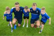 21 July 2016; Josh van der Flier, left, and Ross Molony of Leinster with triplets, left to right, Jack, Conor and Liam Dermody, aged 8, from Portlaoise, Co. Laois, during the Bank of Ireland Leinster Rugby Summer Camp at Portlaoise RFC in Portlaoise, Co. Laois. Photo by Daire Brennan/Sportsfile