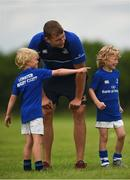 21 July 2016; Billy Cooper, aged 7, from Coolrain, Co. Laois, gives instructions to Ross Molony of Leinster during the Bank of Ireland Leinster Rugby Summer Camp at Portlaoise RFC in Portlaoise, Co. Laois. Photo by Daire Brennan/Sportsfile